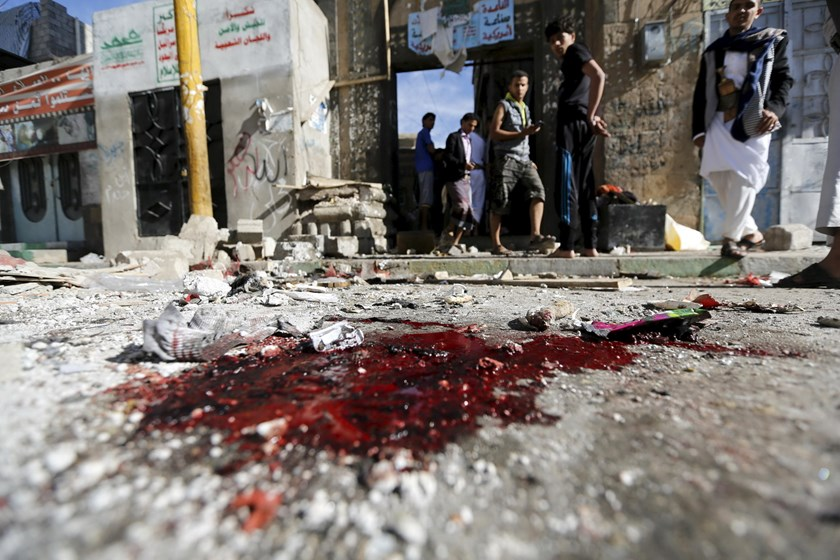 People stand outside the al-Balili mosque after two bombings at the mosque in Yemen's capital Sanaa September 24, 2015. Photo: Reuters/Khaled Abdullah