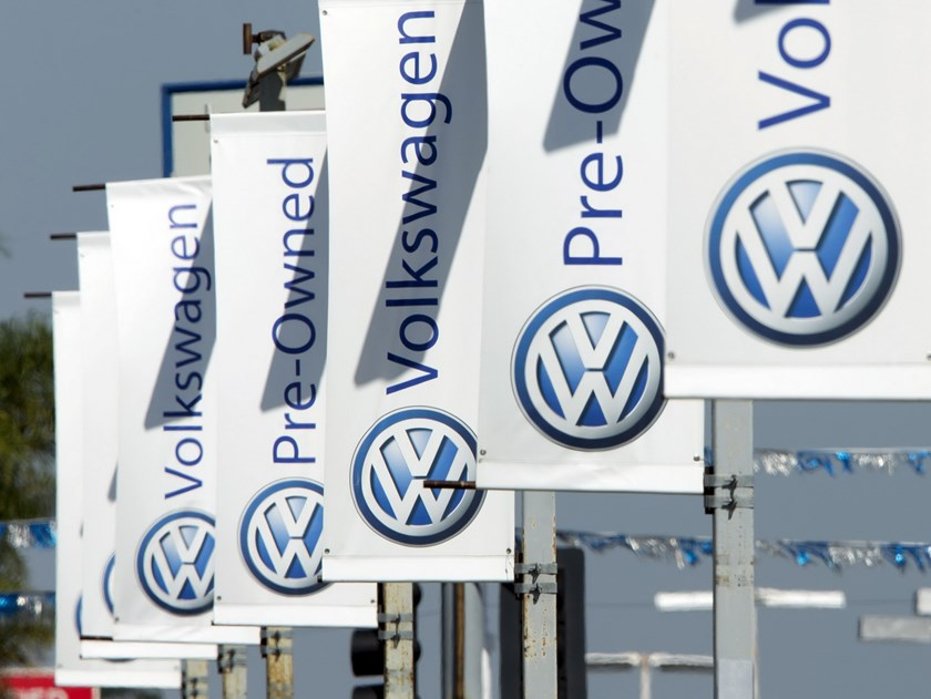Signs hang from light poles at a Volkswagen car dealership in San Diego, California September 23, 2015. Volkswagen Chief Executive Martin Winterkorn resigned on Wednesday, succumbing to pressure for change at the German carmaker, which is reeling from the admission that it deceived U.S. regulators about how much its diesel cars pollute. Photo: Reuters/Mike Blake