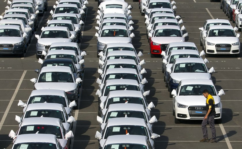 A worker walks among Audi A1 cars in the parking of the Audi powerplant in Brussels, Belgium September 28, 2015. Volkswagen, facing a scandal for the falsification of U.S. emissions tests has said 11 million cars worldwide had defeat devices installed, including 2.1 million of Audi of models A1, A3, A4, A5, A6, TT, Q3 and Q5. Photo: Reuters/Yves Herman