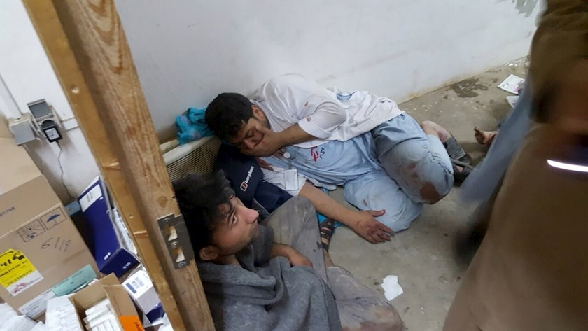 Afghan staff react inside a Medecins Sans Frontieres (MSF) hospital after an air strike in the city of Kunduz, Afghanistan in this October 3, 2015 MSF handout photo. Photo credit: Reuters/Medecins Sans Frontieres/Handout via Reuters