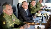 Russian President Vladimir Putin (C) with Defense Minister Sergei Shoigu (L) and armed forces Chief of Staff Valery Gerasimov observe troops in action during a training exercise at the Donguz testing range in Orenburg region, Russia, September 19, 2015. Photo: Reuters/Alexei Nikolsky/RIA Novosti