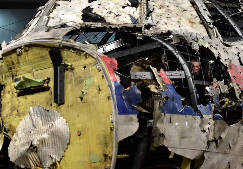The wrecked cockpit of the Malaysia Airlines flight MH17 is presented to the press during a presentation of the final report on the cause of its crash at the Gilze Rijen airbase October 13, 2015. Photo: AFP/Emmanuel Dunand