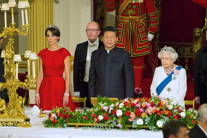 Chinese President Xi Jinping with the Duchess of Cambridge and Queen Elizabeth II at a state banquet at Buckingham Palace, London, during the first day of his state visit to Britain. Tuesday October 20, 2015. Photo: Reuters/Dominic Lipinski