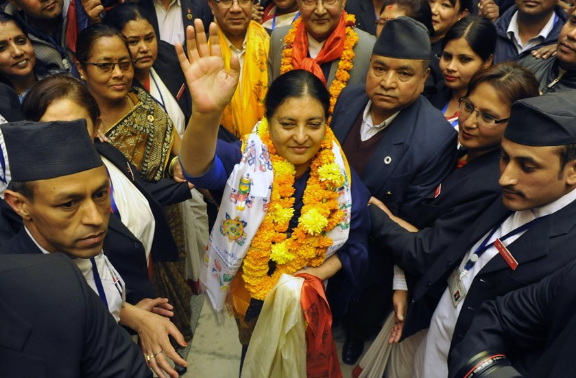 Nepalese newly elected president Bidhya Bhandari (C) greets supporters as she leaves parliament after her election win was announced in Kathmandu on October 28, 2015. Photo: AFP/Prakash Mathema