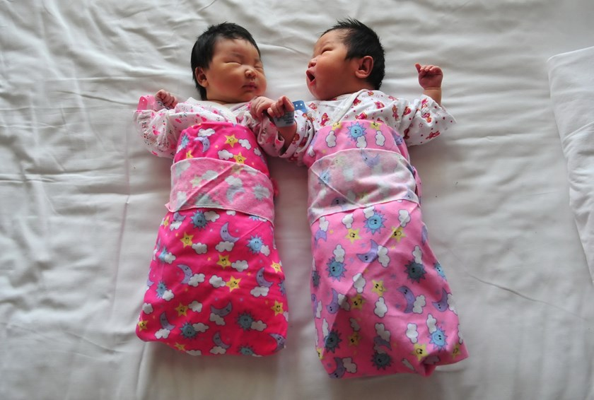 In this file picture taken on December 1, 2008, newborn babies lie on a hospital bed in Beijing. China announced the end of its hugely controversial one-child policy on October 29, 2015, with the official Xinhua news agency saying that all couples would be allowed two children. Photo: AFP/Files/Frederic J. Brown