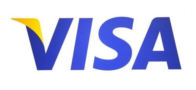 A Visa logo is seen during the International CTIA WIRELESS Conference & Exposition in New Orleans, Louisiana May 9, 2012. Photo: Reuters/Sean Gardner