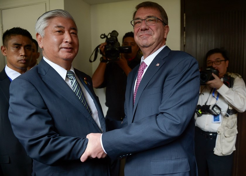 US Secretary of Defense Ashton Carter (R) shakes hands with Japan's Defense of Minister Gen Nakatani (L) before a bilateral meeting during the Association of Southeast Asian Nations (ASEAN) Defense Ministers' meeting in Subang, on the outskirts of Kuala Lumpur on November 3, 2015. Photo: AFP/Mohd Rasfan