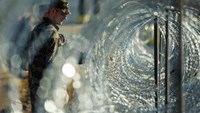Slovenian soldiers build a razor wire fence on the Slovenian-Croatian border in Gibina, northeastern Slovenia, on November 11, 2015. Slovenia's army began on November 11 rolling out razor wire along the border with Croatia, in a move billed by the government as designed to better manage the influx of migrants. Photo: AFP/Jure Makovec