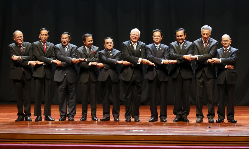 Leaders hold hands as they pose for photographers on stage at the opening of the ASEAN Summit in Kuala Lumpur November 21, 2015. The leaders are (L-R) Philippine's President Benigno Aquino, Indonesia's President Joko Widodo, Cambodia's Prime Minister Hun Sen, Brunei's Sultan Hassanal Bolkiah, Laos' Prime Minister Thongsing Thammavong, Malaysia's Prime Minister Najib Razak, Vietnam's Prime Minister Nguyen Tan Dung, Thailand's Prime Minister Prayuth Chan-ocha, Singapore's Prime Minister Lee Hsien