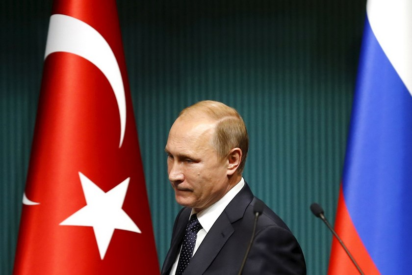Russian President Vladimir Putin arrives for a news conference at the Presidential Palace in Ankara, Turkey in this December 1, 2014 file photo. Putin signed a decree imposing economic sanctions against Turkey on Saturday, four days after Turkey shot down a Russian warplane near the Syrian-Turkish border. Photo: Reuters/Umit Bektas/Files