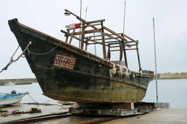 Unidentified wooden boat which was found in the sea off Noto Peninsula, is seen in Wajima, Japan, in this photo taken by Kyodo November 29, 2015. Photo credit: Reuters/Kyodo