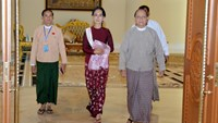 Myanmar's President Thein Sein (R) walks with National League for Democracy (NLD) party leader Aung San Suu Kyi during a meeting in Naypyitaw December 2, 2015. This is their first meeting after Suu Kyi's NLD party won a historic election in November. Photo: Reuters/Myanmar News Agency/Handout via Reuters