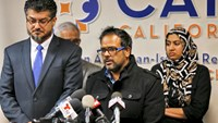 Farhan Khan (C), brother-in-law of San Bernardino shooting suspect Syed Farook, speaks at the Council on American-Islamic Relations during a news conference in Anaheim, California, December 2, 2015. Photo: Reuters/Mike Blake