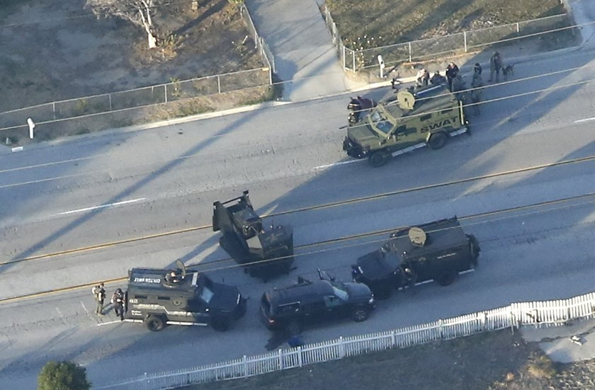 An SUV with its windows shot out that police suspect was the getaway vehicle from the scene of a shooting in San Bernardino, California is shown in this aerial photo December 2, 2015. Photo: Reuters/Mario Anzuoni