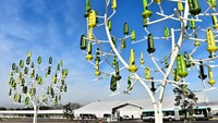 "A picture taken on December 3, 2015 shows ""wind trees"", a renewable energy innovation constructed in the shape of a tree, where each ""leaf"" acts as a mini wind-turbine to generate electricity, displayed at the COP21, the United Nations conference on climate at Le Bourget, on the outskirts of Paris. More than 150 world leaders are meeting under heightened security, for the 21st Session of the Conference of the Parties to the United Nations Framework Convention on Climate Change (COP21/CMP11), als"