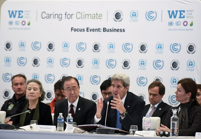 "U.S. Secretary of State John Kerry (front 2nd R) delivers a speech next to United Nations Secretary-General Ban Ki-moon (front 2nd L) during the ""Caring for Climate Business Forum"" event as part of the COP21 United Nations conference on climate change December 8, 2015 in Le Bourget, on the outskirts of Paris. Photo: Reuters/Mandel Ngan/Pool"