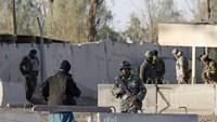 Afghan security forces stand guard at the entrance gate of Kandahar Airport where Taliban stormed on late Tuesday, in Kandahar, Afghanistan December 9, 2015. Reuters/Stringer