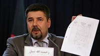 A file photo shows Rahmatullah Nabil, head of Afghanistan's National Directorate Of Security, showing a paper during a joint news conference in Kabul September 7, 2011. Photo: Reuters/Omar Sobhani