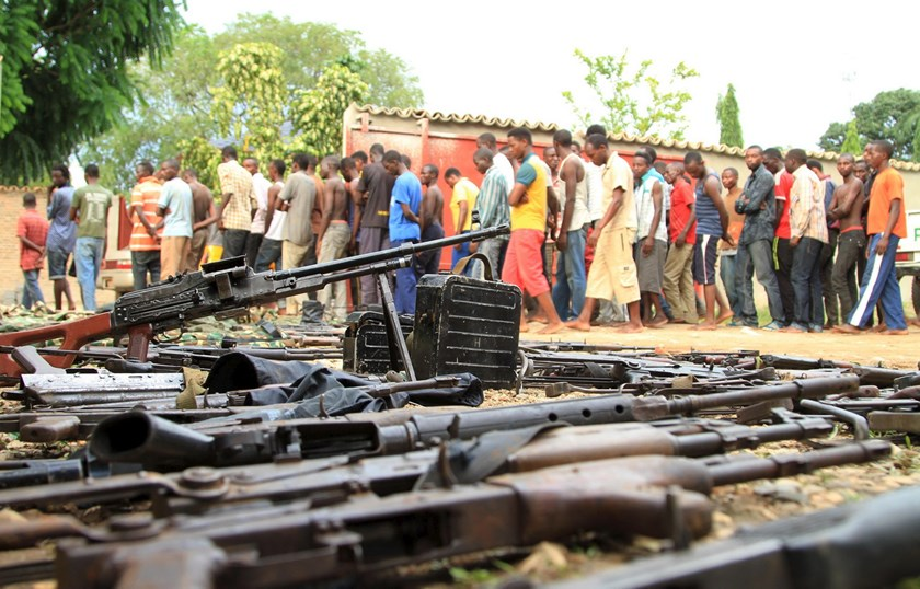 Suspected fighters are paraded before the media by Burundian police near a recovered cache of weapons after clashes in the capital Bujumbura, Burundi December 12, 2015. Photo: Reuters/Jean Pierre Aime Harerimana