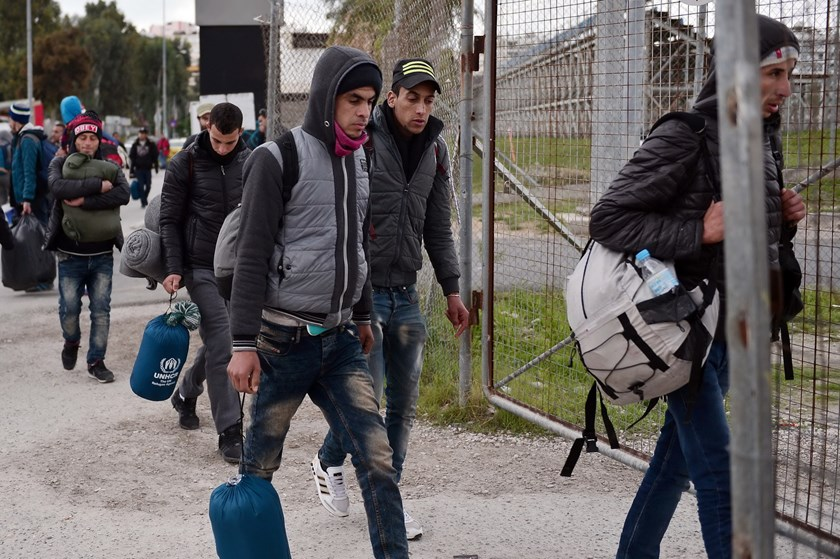 Migrants and refugees arrive at a temporary housing facility for migrants located in a former Olympic hall in Faliro suburb of Athens on December 11, 2015. Photo: AFP/ Louisa Gouliamaki