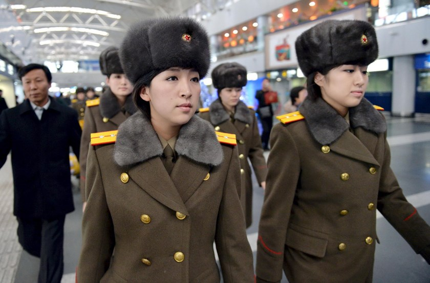 Members of the Moranbong Band of North Korea arrive at Beijing International Airport before departing from Beijing, China in this photo taken by Kyodo December 12, 2015. The band, formed by North Korean leader Kim Jong Un, was visiting China along with the North's State Merited Chorus and was due to perform later on Saturday at Beijing's National Center for the Performing Arts, Kyodo reported. Photo: REUTERS/Kyodo