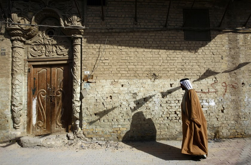 An Iraqi man walks in the old city of Samawa in southern Iraq on December 13, 2015. Photo: AFP/Haidar Hamdani