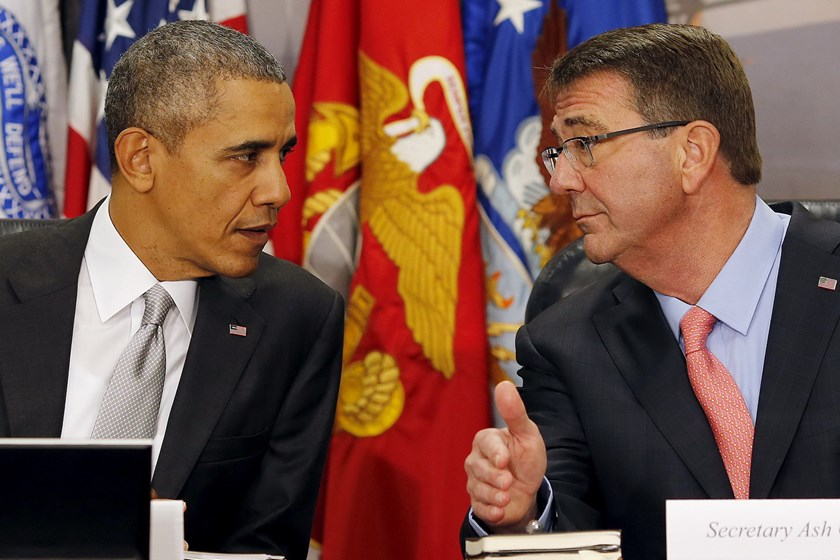 U.S. President Barack Obama talks to U.S. Defense Secretary Ash Carter as they attend a National Security Council meeting on the counter-Islamic State campaign at the Pentagon in Washington December 14, 2015. Photo: Reuters/Carlos Barria