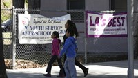 A woman and two kids walk past Elysian Heights Elementary School in the Echo Park neighborhood of Los Angeles, California December 15, 2015. Photo: Reuters/Jason Redmond