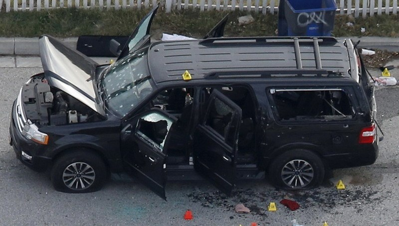 The black SUV rented by the couple who carried out the Dec. 2 attack is shown after an intense shootout between police and the two attackers. Police fired 380 rounds of ammunition during the gun battle, which left the two shooters dead. Photo: Reuters/Mario Anzuoni
