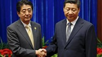 China's President Xi Jinping (R) shakes hands with Japan's Prime Minister Shinzo Abe during their meeting at the Great Hall of the People, on the sidelines of the Asia Pacific Economic Cooperation (APEC) meetings, in Beijing in this November 10, 2014 file photo. Photo: Reuters/Kim Kyung-Hoon