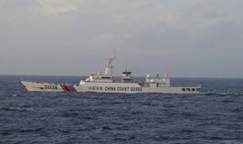 Japan says armed Chinese coastguard ship seen near disputed islands