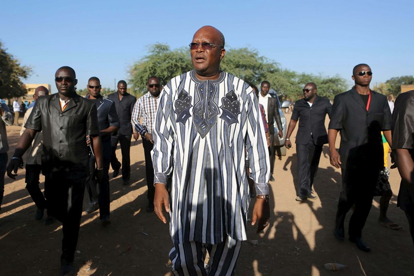 Presidential candidate Roch Marc Kabore (C) arrives to vote during the presidential and legislative election at a polling station in Ouagadougou, Burkina Faso, in this November 29, 2015 file photo. Photo: Reuters/Joe Penney/Files