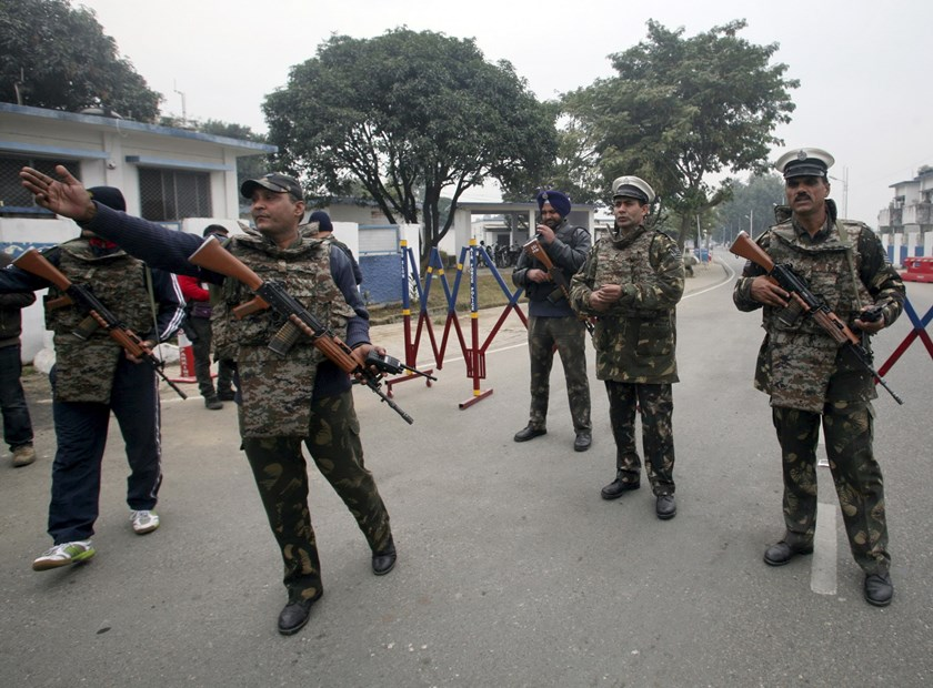 Indian security personnel stand guard inside the Indian Air Force (IAF) base at Pathankot in Punjab, India, January 4, 2016. Indian security forces were working on Monday to carefully defuse grenades in the final stages of an operation to secure a vast air base near the border with Pakistan, two days after a militant attack killed seven military personnel and wounded 22. Photo: Reuters/Mukesh Gupta