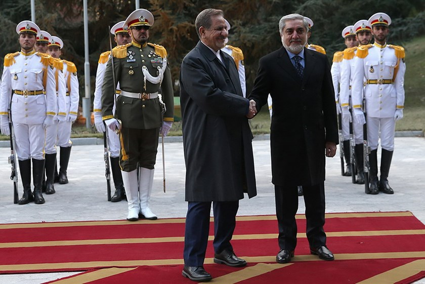 A handout picture provided by the office of Iranian President Hassan Rouhani shows Iran's First Vice President Eshaq Jahangiri (L) greeting Afghan Chief Executive Abdullah Abdullah upon his arrival in Tehran on January 4, 2016. Photo: AFP/HO/ IRANIAN PRESIDENCY