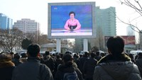 North Korean people watch a huge screen broadcasting the government's announcement in Pyongyang, North Korea, in this photo released by Kyodo January 6, 2016. Photo credit: Reuters/Kyodo
