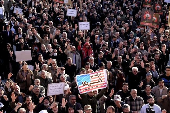 Protesters chant slogans during a demonstration against the execution of Sheikh Nimr al-Nimr in Saudi Arabia, at Imam Hussein square in Tehran January 4, 2016. Photo: Reuters/Raheb Homavandi/