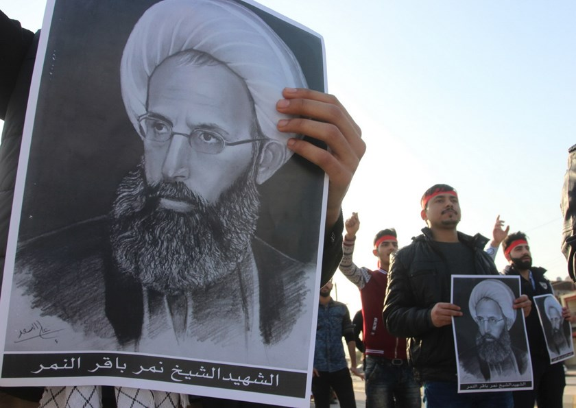 Shi'ite Muslims hold pictures of Shi'ite Muslim cleric Nimr al-Nimr during a protest against his execution in Saudi Arabia, in Basra, January 6, 2016. Photo: Reuters/Essam Al-Sudani