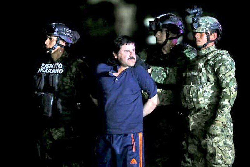 Joaquin 'El Chapo' Guzman is escorted by soldiers during a presentation at the hangar belonging to the office of the Attorney General in Mexico City, Mexico January 8, 2016. Photo: Reuters/Edgard Garrido