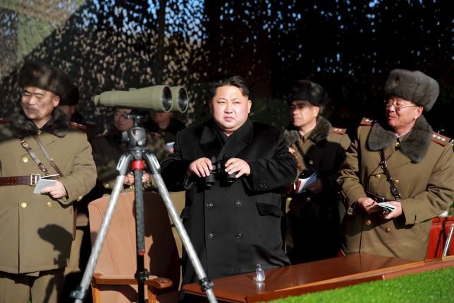 North Korean leader Kim Jong Un (C) watches a firing contest of the KPA artillery units at undisclosed location in this photo released by North Korea's Korean Central News Agency (KCNA) in Pyongyang on January 5, 2016. Photo: Reuters/KCNA
