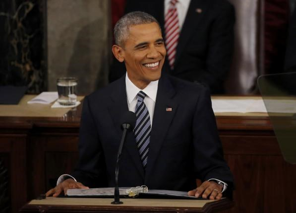 U.S. President Barack Obama smiles as he delivers his State of the Union address to a joint session of Congress in Washington, January 12, 2016. Photo: Reuters/Carlos Barria