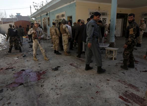 Afghan security forces inspect the site of a suicide attack in Jalalabad, Afghanistan January 17, 2016. Photo: Reuters/ Parwiz