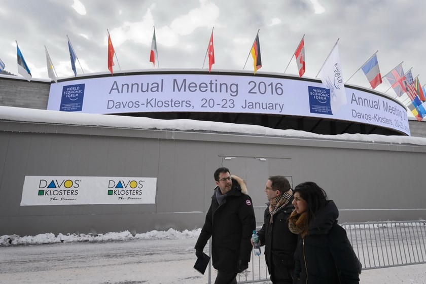 People walk past the Congress Center at the opening of the World Economic Forum (WEF) annual meeting in Davos, on January 19, 2016. Photo: AFP/Fabrice Coffrini