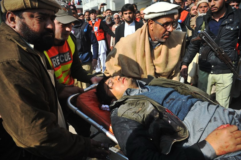 Pakistani rescuers shift an injured man to a hospital following an attack by gunmen in the Bacha Khan university in Charsadda, about 50 kilometres from Peshawar, on January 20, 2016. Photo: AFP/A Majeed
