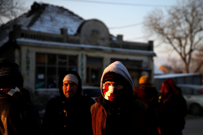 Migrants wait in line inside a registration camp in Presevo, Serbia, January 20, 2016. Photo: Reuters/Marko Djurica