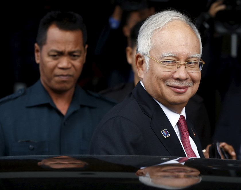 Malaysia's Prime Minister Najib Razak leaves parliament in Kuala Lumpur, Malaysia, January 26, 2016. Malaysia's attorney-general said on Tuesday that $681 million transferred into Prime Minister Najib Razak's personal bank account was a gift from the royal family in Saudi Arabia and there were no criminal offences or corruption involved. Photo: Reuters/Olivia Harris