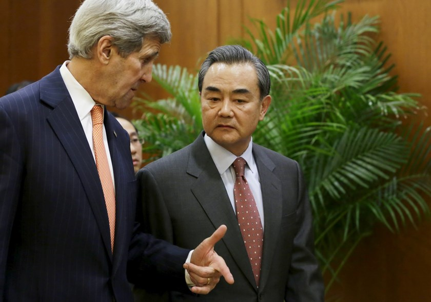 U.S. Secretary of State John Kerry (L) gestures as he and China's Foreign Minister Wang Yi arrive for a joint news conference at the Ministry of Foreign Affairs, in Beijing, China, January 27, 2016. Photo: Reuters/Jason Lee