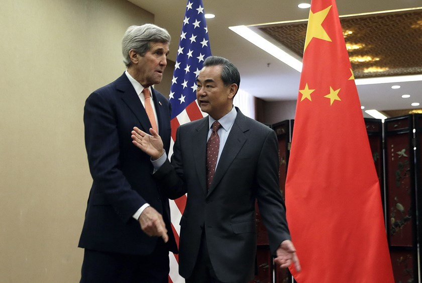 U.S. Secretary of State John Kerry (L) meets with Chinese Foreign Minister Wang Yi before their bilateral meeting at the Ministry of Foreign Affairs in Beijing January 27, 2016. Photo: Reuters/Andy Wong/Pool
