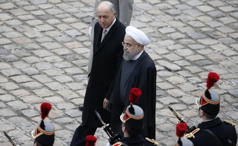 French Foreign Affairs Minister Laurent Fabius (top) and Iran's President Hassan Rouhani review troops as they attend a ceremony in the courtyard of the Hotel des Invalides in Paris, France, January 28, 2016. Photo: Reuters/Jacky Naegelen
