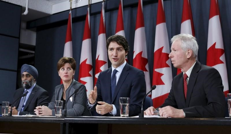 Canada's Prime Minister Justin Trudeau (2nd R) speaks during a news conference with Defence Minister Harjit Sajjan (L), International Development Minister Marie-Claude Bibeau (2nd L) and Foreign Minister Stephane Dion in Ottawa, Canada, February 8, 2016. Photo: Reuters/Chris Wattie