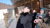 North Korean leader Kim Jong Un (C) watches a long range rocket launch into the air in North Korea, in this photo released by Kyodo February 7, 2016. Photo: REUTERS/KYODO